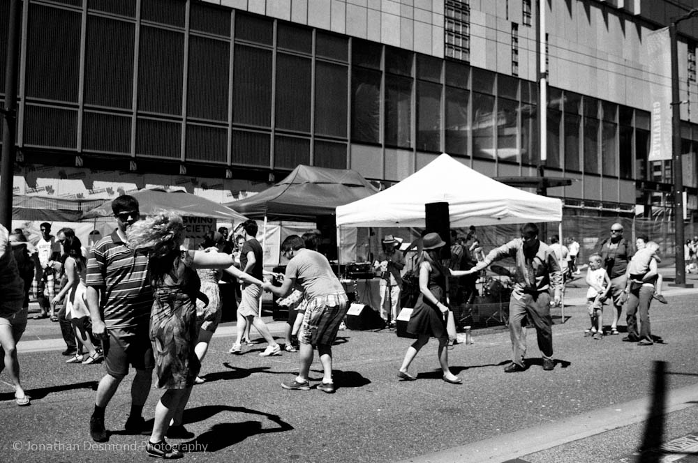 """Right next to the old Sears building, a crowd of dancers were """"busting a move"""" to some music placed by a live band in the white tented area. It was really awesome to see Vancouver so lively. We should do this more often!"""