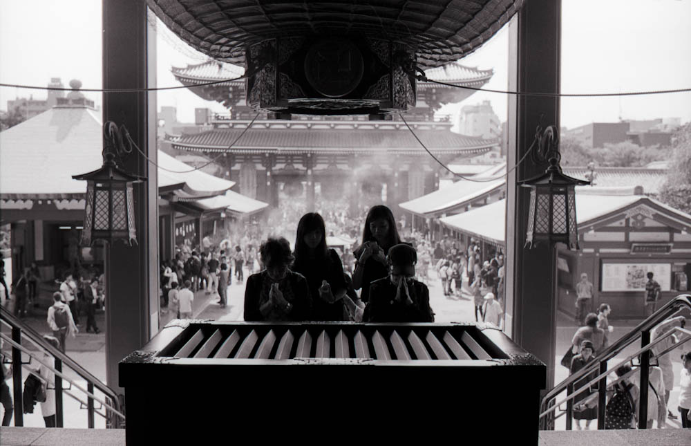 Senso-ji (Asakusa), Tokyo - you could hear the coins drop in between the wooden separations just before people prayed.