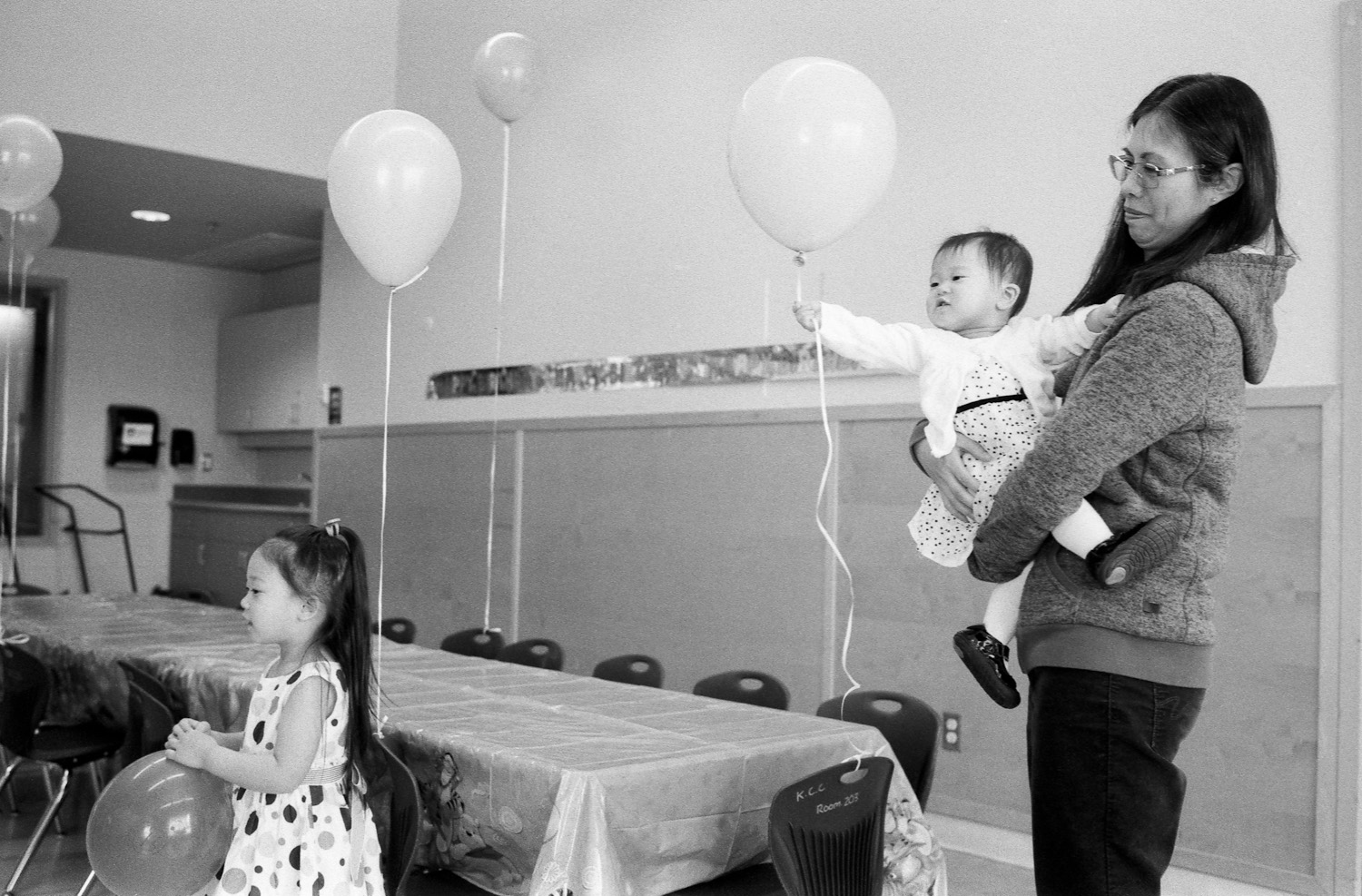 Here you can see Hannah (a little more grown up) and baby Abigail on the right waving around a balloon.