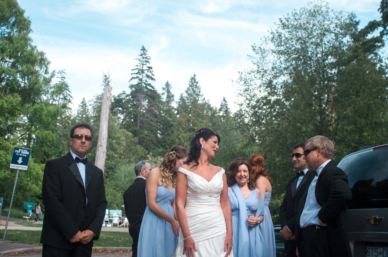 I love how the sunglasses on the groomsmen contrasts with the sky blue dresses of the bridesmaid and the bride in the center of it all.