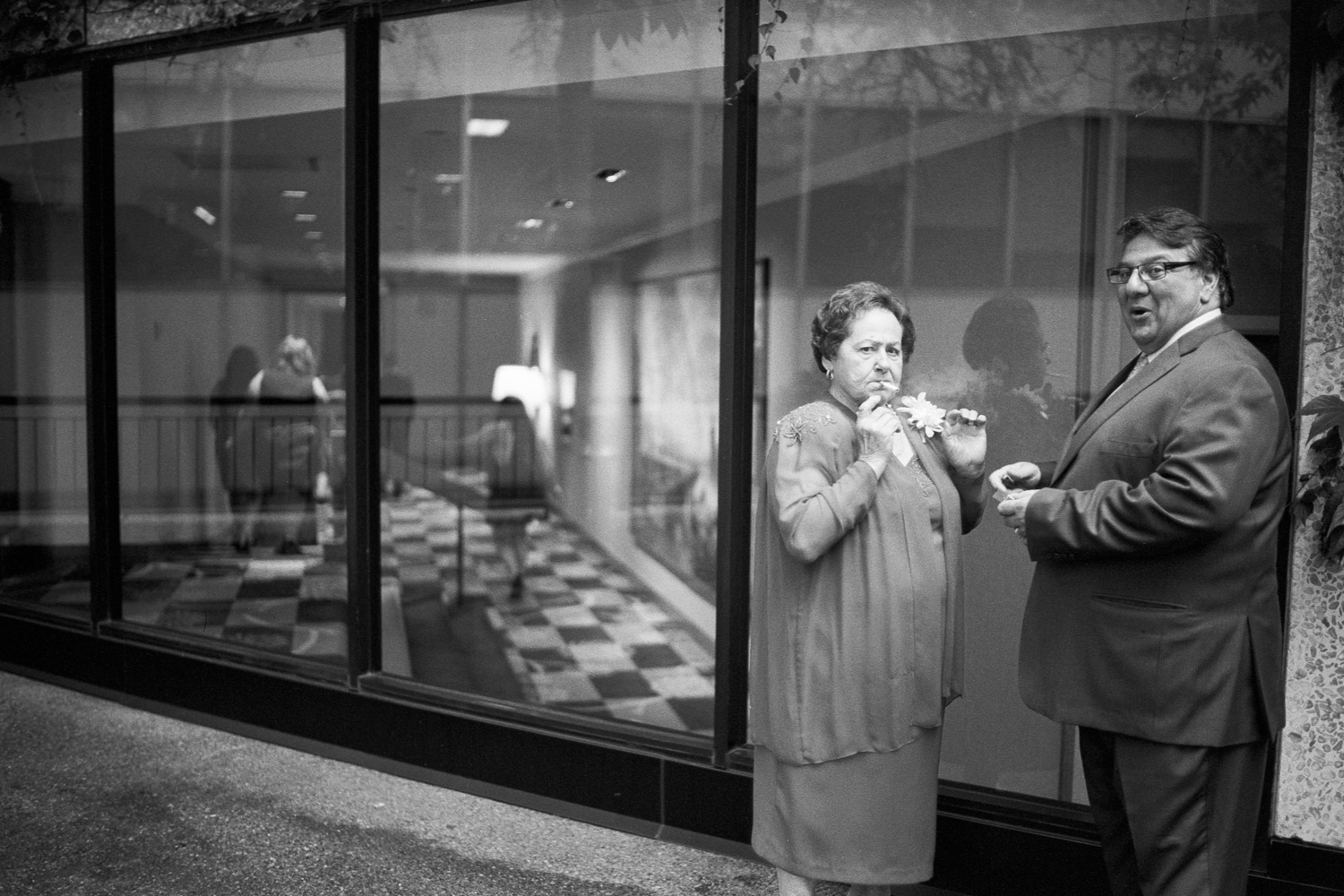 One of my favorite moments of 2015 :) We had just finished a request for a family group photograph and I saw these two starting to light up a cigarette. As I was walking towards the door, I quickly aligned my camera settings, set focus and clicked the shutter JUST as they saw me taking their photograph.