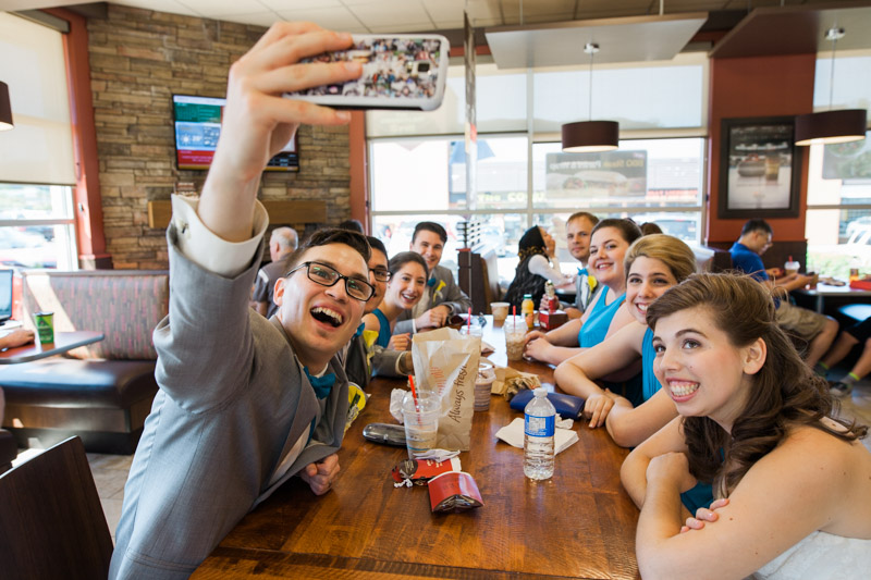 You know, wedding days can be really long days and sometimes you just need a break. I followed the bride, groom and the entire wedding party to Tim Hortons, where I spent some time with them and caught them doing a selfie. Timmies on your wedding day? Heck yeah!!  (Seconding with Natahsha Priya Photography)