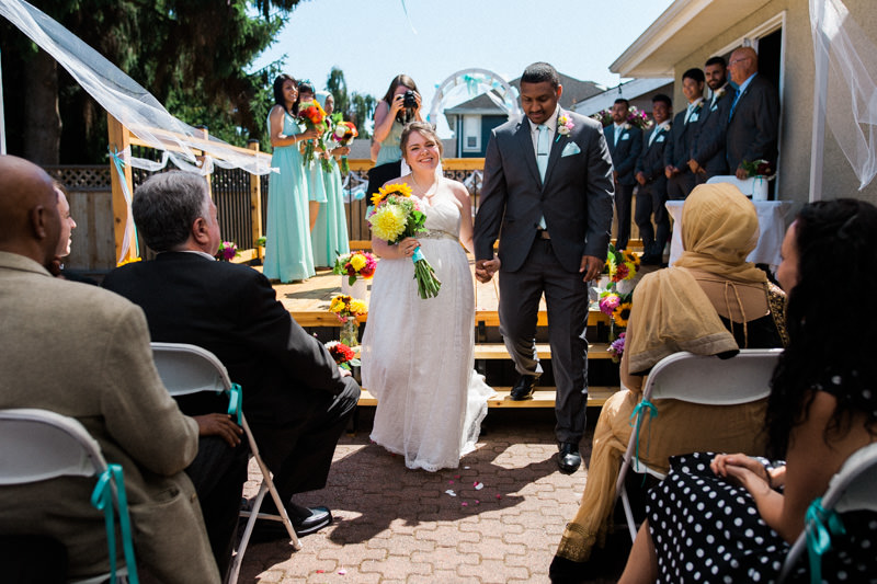 I loved how this wedding was so very small but very intimate and personal. It took place in a backyard! That's Stefanie Cepeda in the background with the camera.