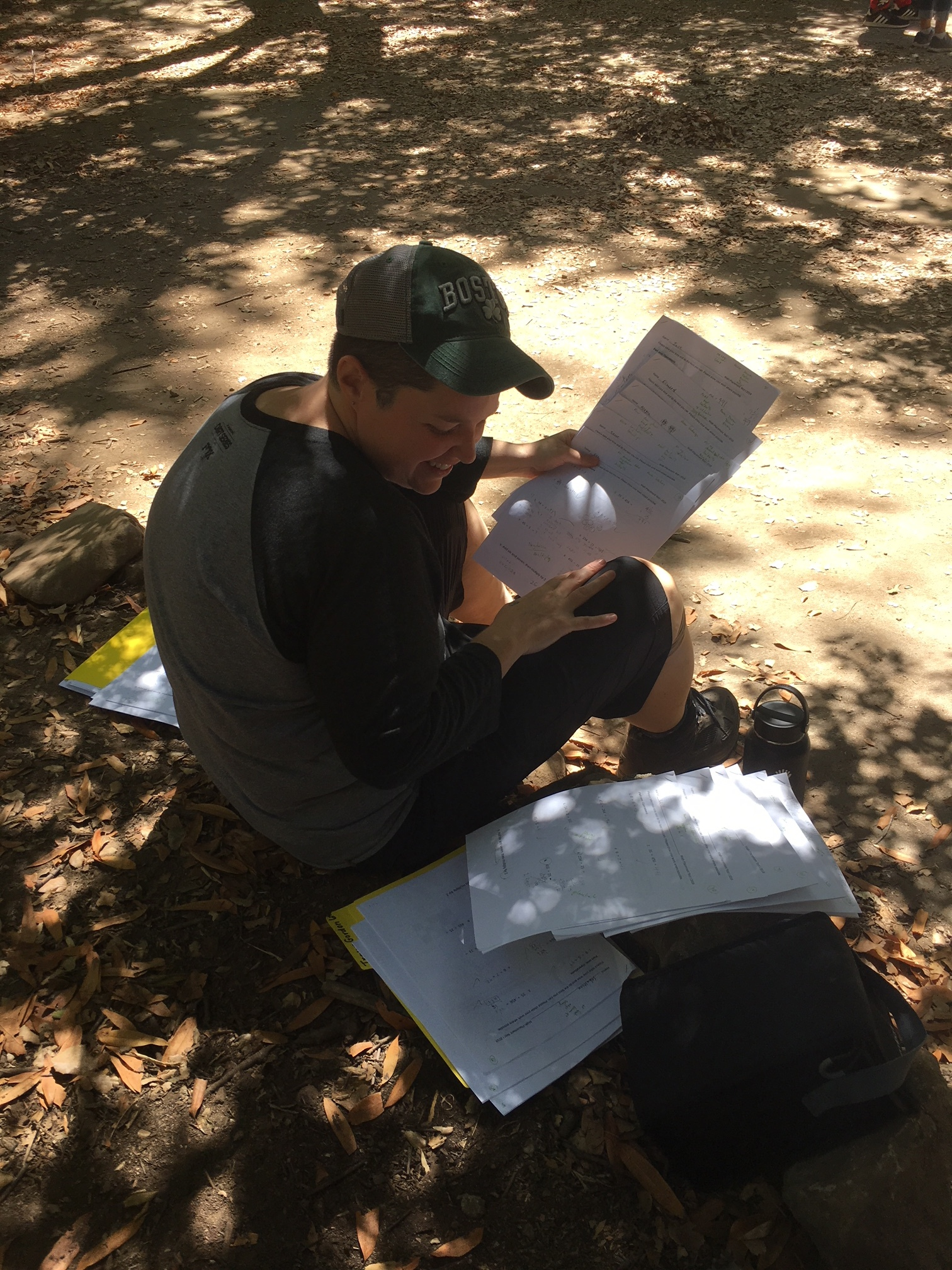 Katie grading math assessments in nature!