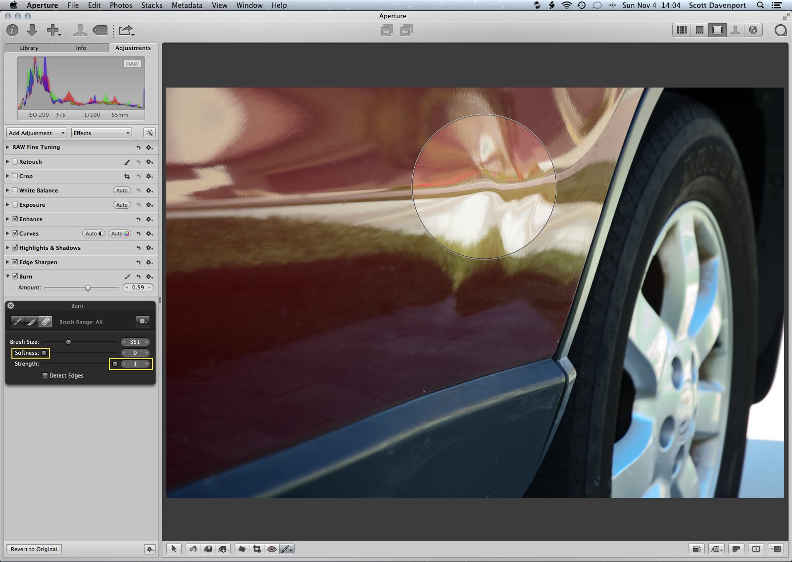 Apply 'Burn' to the entire photo, then brush away a portion with a hard-edged brush