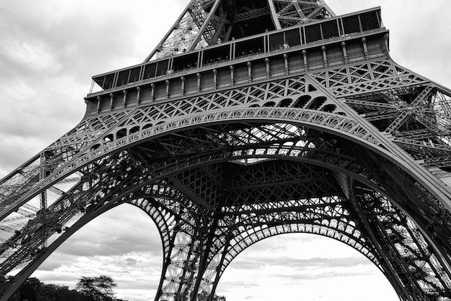 The base and swooping arch draw the eye up the Eiffel Tower.