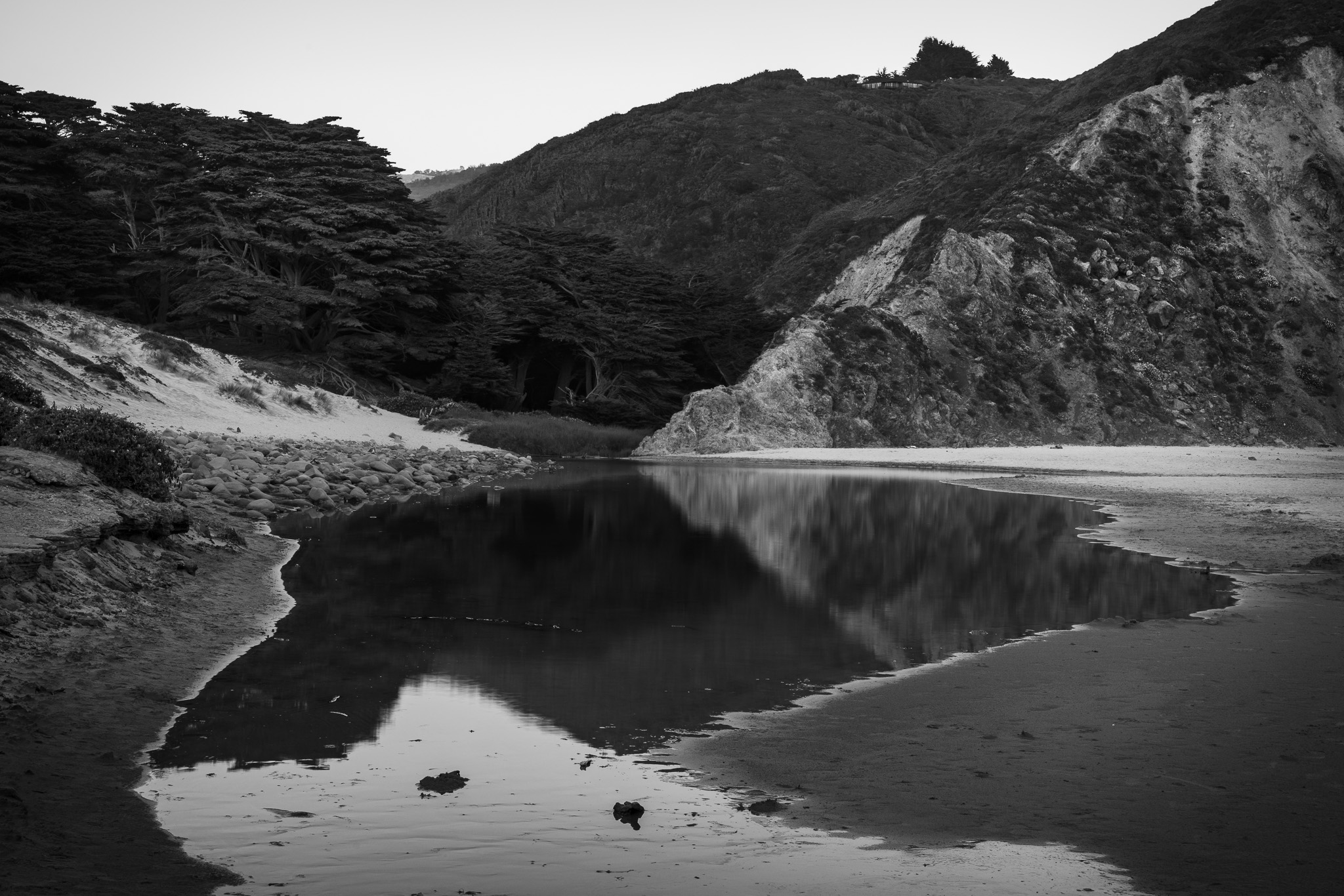 Reflections in a pool at Pfeiffer Beach, Big Sur