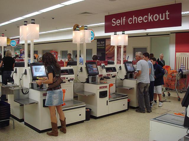Self-checkouts (source:  Wikimedia Commons )