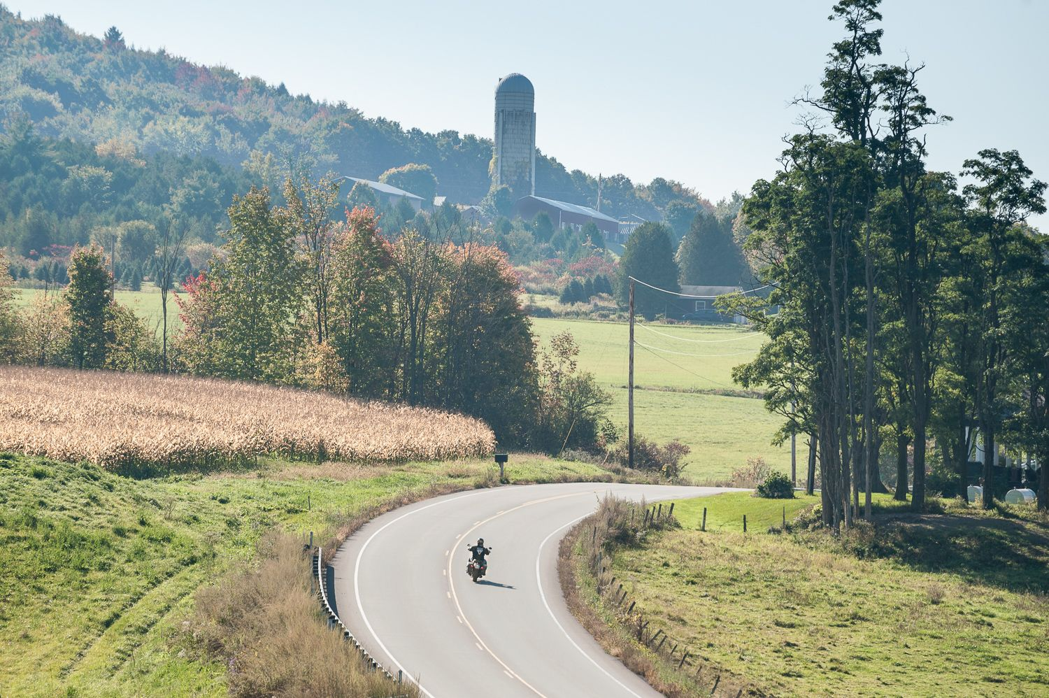 A lone rider rounds a corner on a fall morning on VT-116. Photo by Bob LoCicero