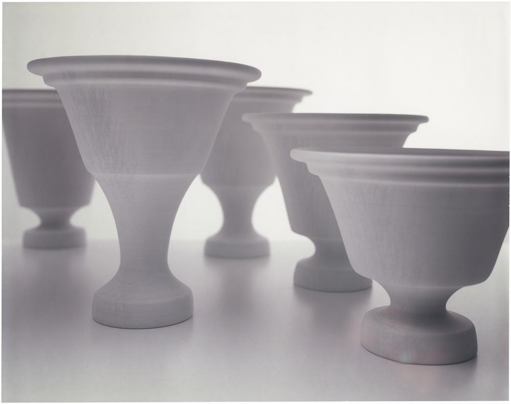 The Paper Vase   Year : 2007  Materials : paper, wood glue  Dimensions :Type 1 / 300x250x250 mm,Type 2 /300x250x250 mm,Type 3 /300x250x250 mm,Type 4 / 250x250x250 mm,Type 5 / 200x250x250 mm  Collection : Museum Boijmans van Beuningen / Type 3  Edition :10 pieces per each type