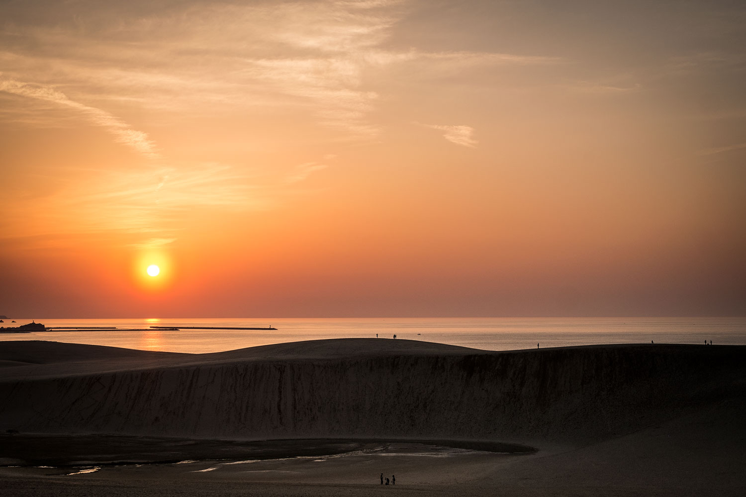 The sunset of the Tottori desert dunes.
