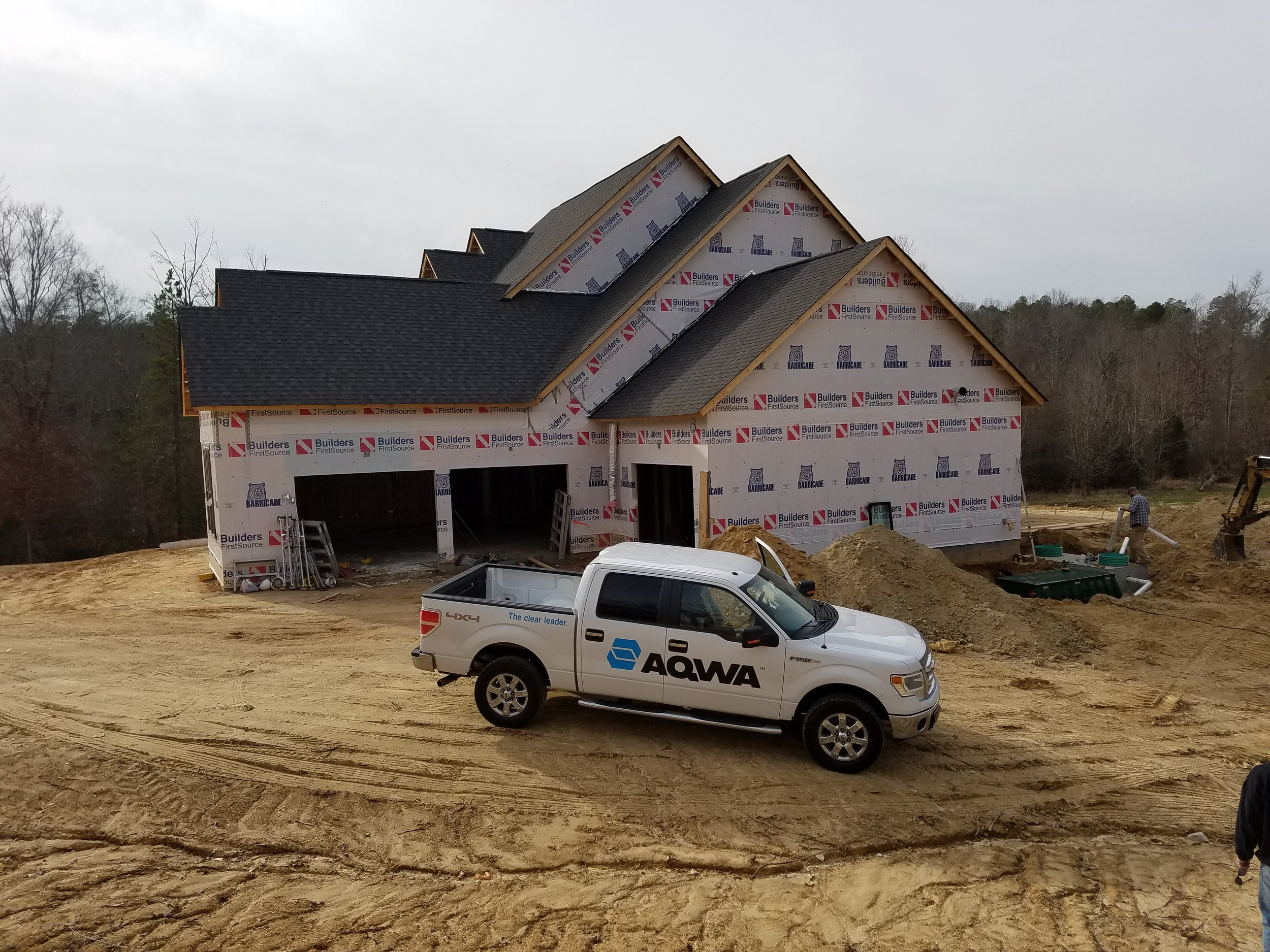 An AX20RT with drip irrigation drain field being installed by at a 4 bedroom home in Lancaster, SC.