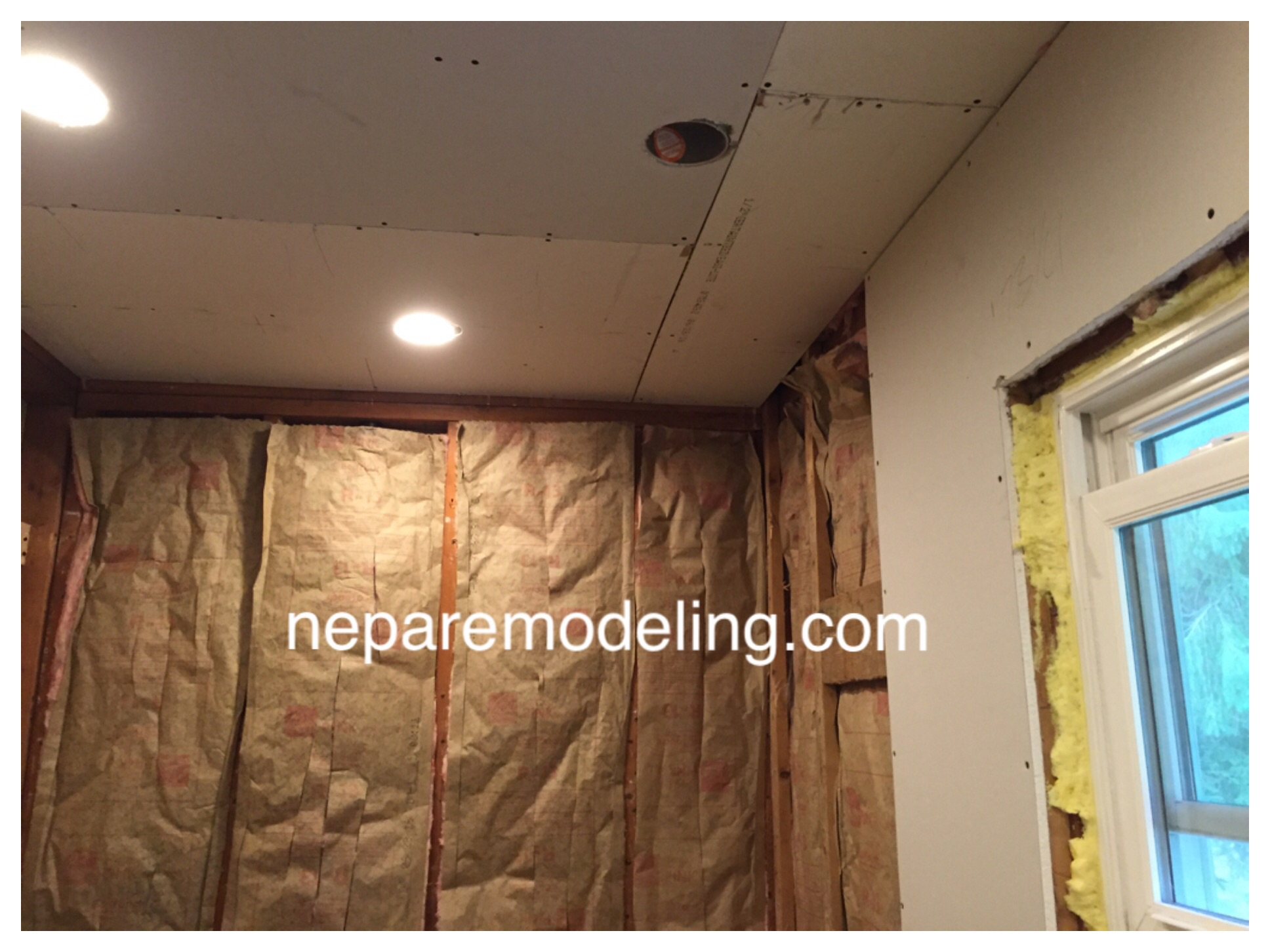 After demo, electrical, and plumbing were completed, batt insulation was added to the interior walls to reduce noise transferring to adjacent bedrooms. Drywall was installed to replace the existing plaster wall tile.