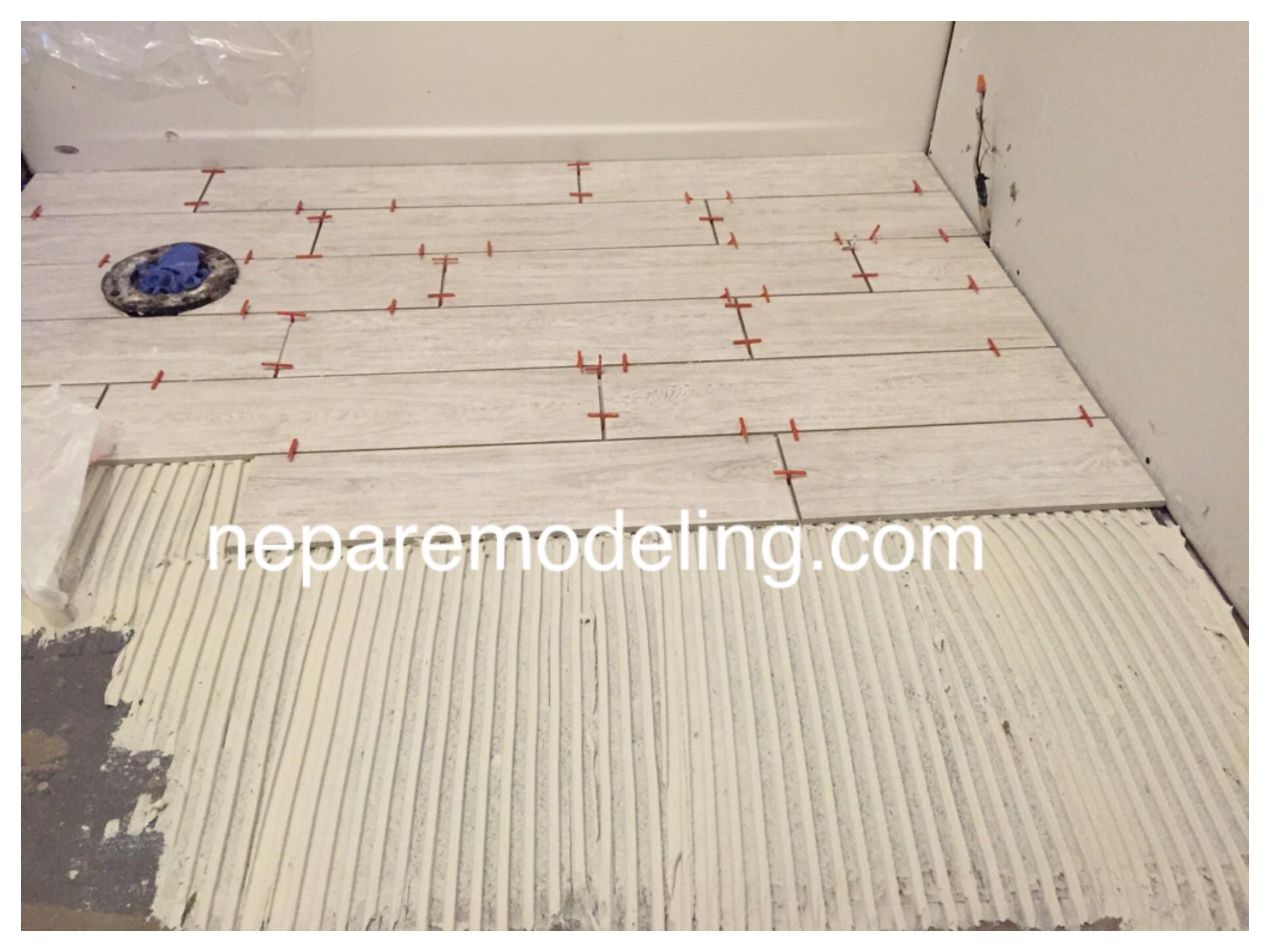 "6""x24"" porcelain floor tile installation."