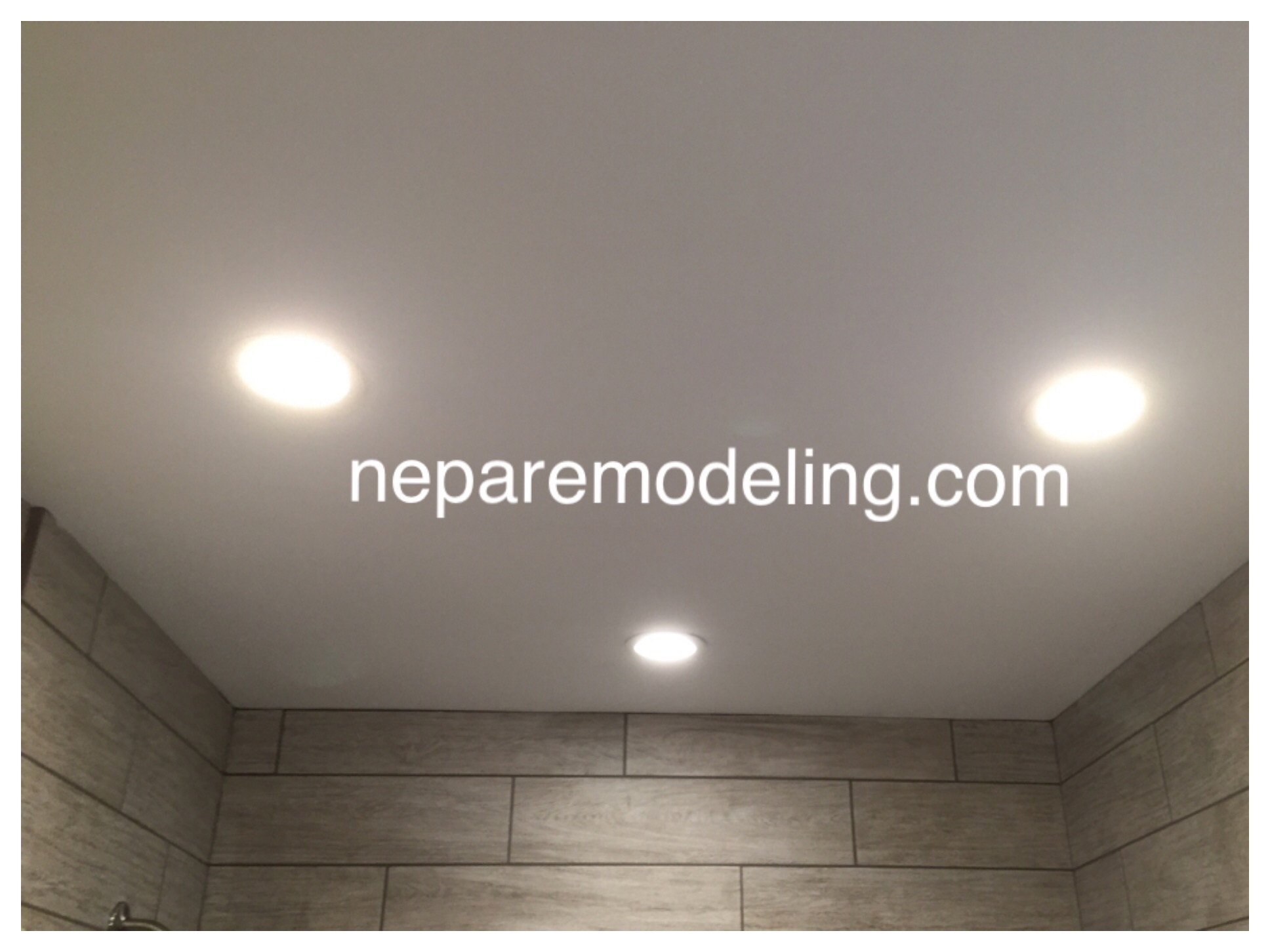 Recessed lighting to provide even light distribution throughout the room.