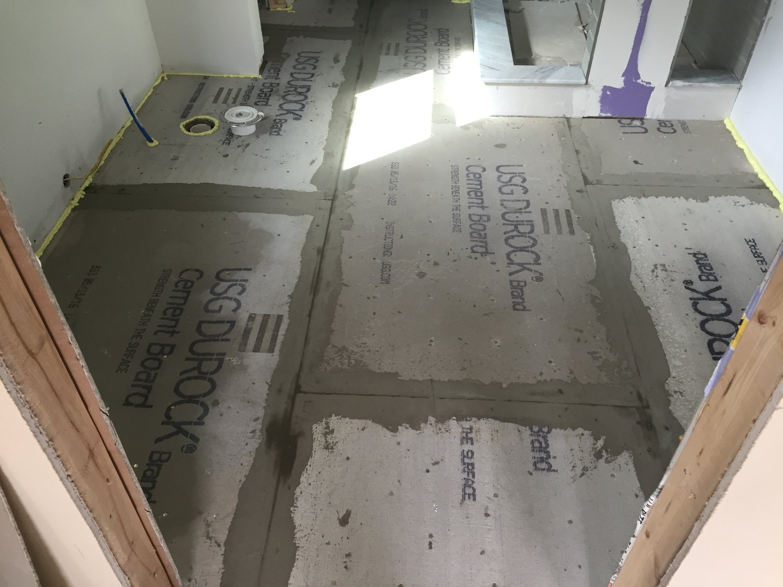 """1/4"""" Durock installed during a bathroom remodel in Scranton PA. Modified thinset used to install the cement board and tape the seams."""