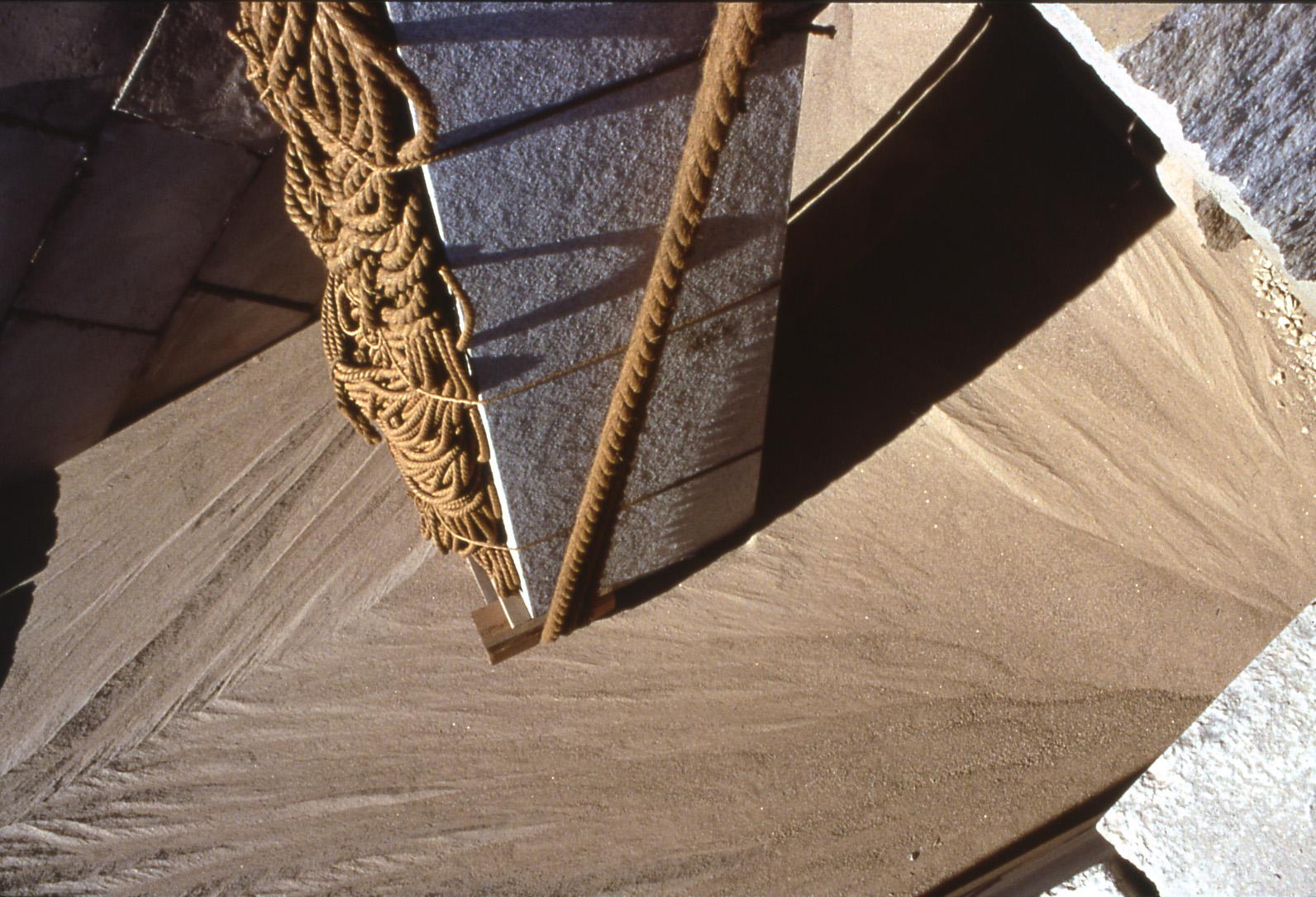 Obelisk on sand flow.jpg