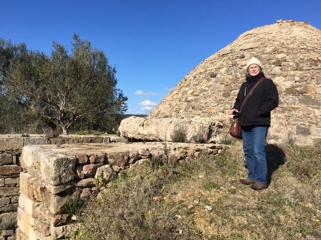 Laura in front of a tholos (beehive) tomb at the Palace of Nestor.