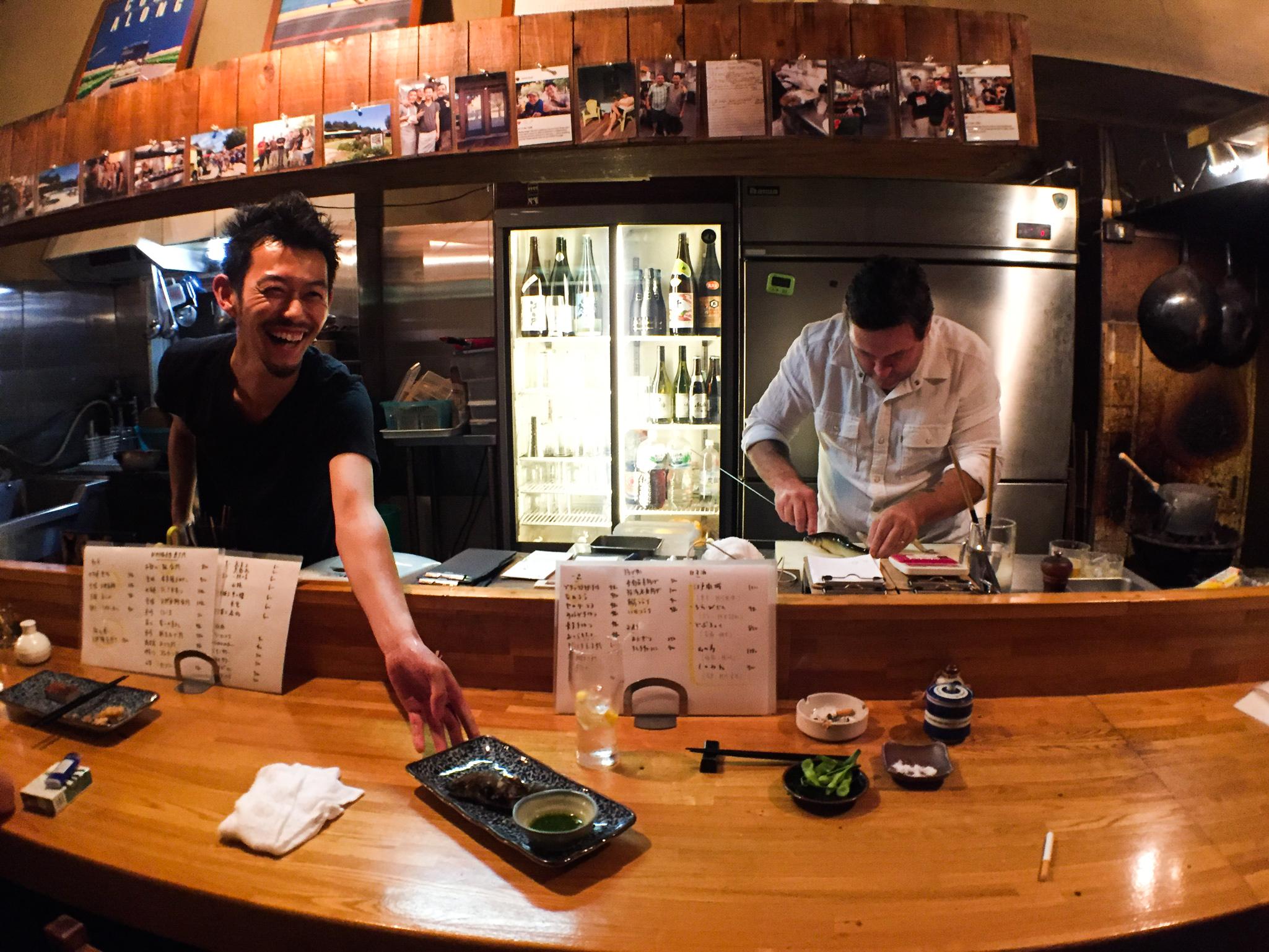 Satoshi and Billy prepare Ayu, a river fish, on skewers at Hiro izakaya.