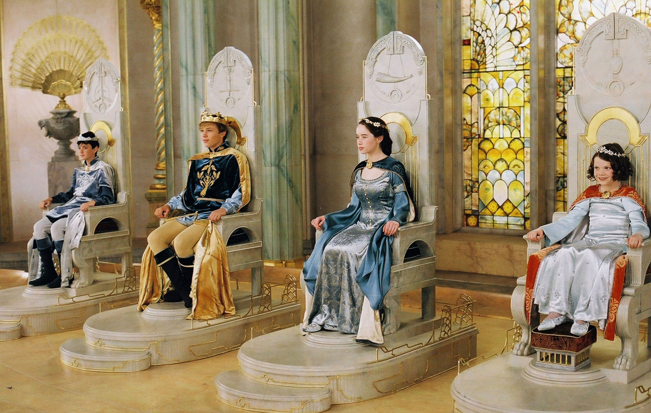 High King Peter, King Edmund, Queen Susan, and Queen Lucy at their coronation, at Cair Paravel in throne