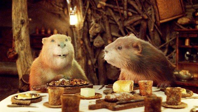Mr. & Mrs. Beaver having dinner in their dam with The Pevensies