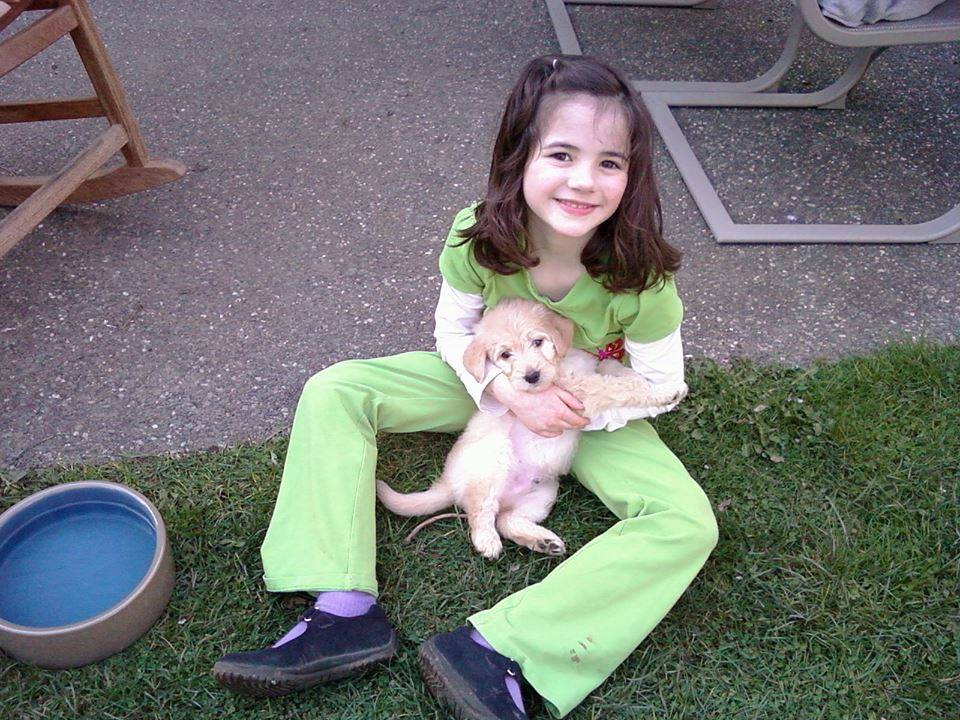 FRIDAY  TBT: this sweet little puppy is 5 years old today!! (And that darling little girl is now a feisty 5th grader!) How'd that happen?! Thanks, Star View Kennels   — with Jenna M. Byrnes