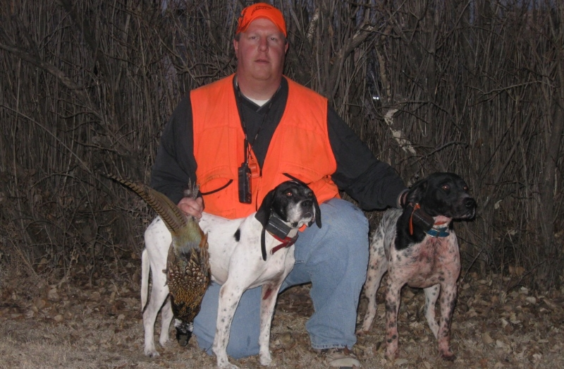 Chris Lecuyer with his bird dogs after a successful hunt.