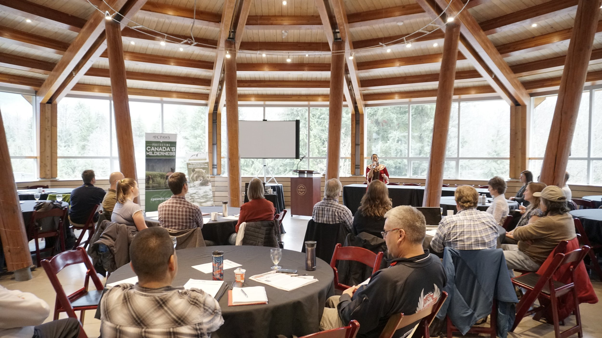 Laura Grizzlypaws of the St'át'imc Nation speaking to the Coast to Cascades-Grizzly Bear Symposium. Photo (c) Jeremy Williams.