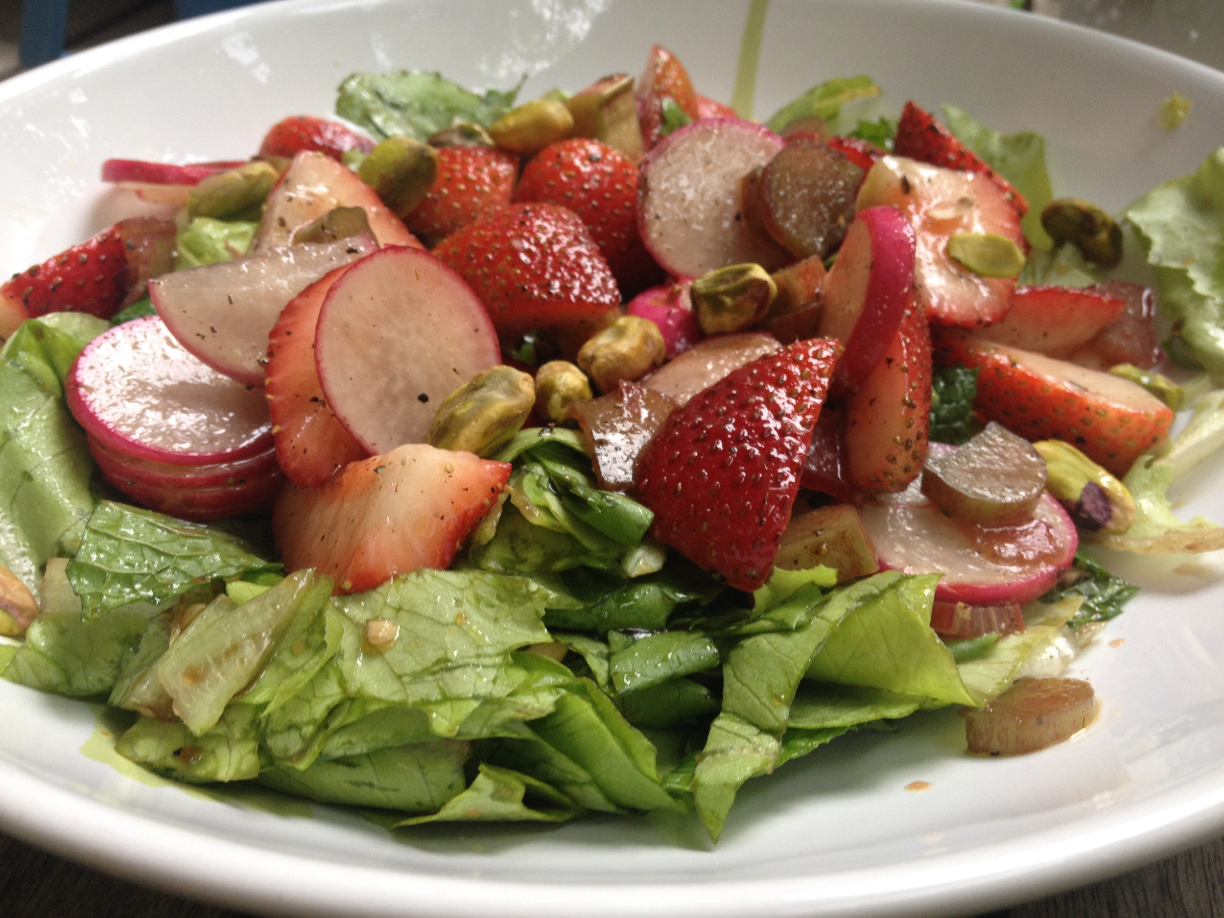Louisa Shaifa's Radish, Rhubarb, and Strawberry Salad from  The New Persian Kitchen  features a balsamic vinaigrette with cracked black pepper.