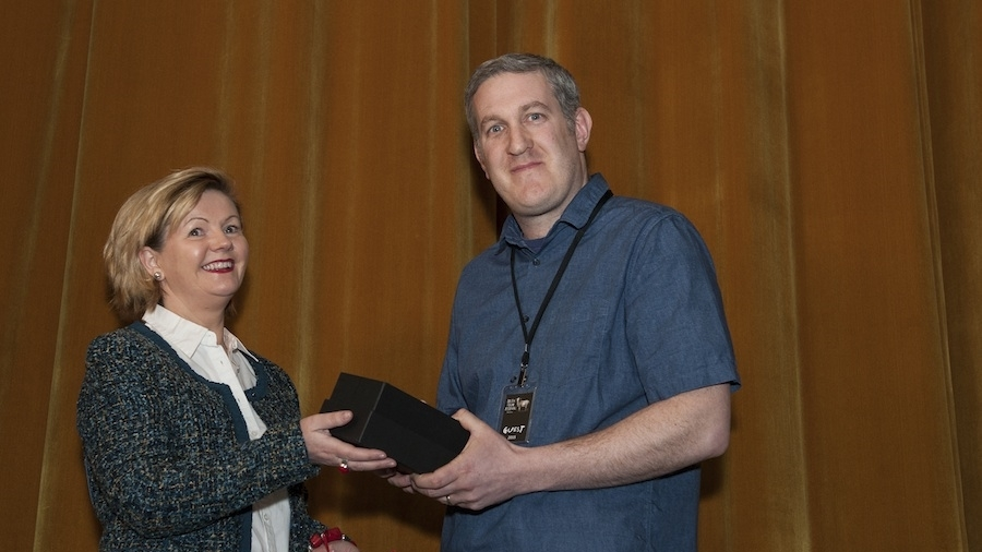 Paul Murphyis presented with the Director's Choice Best Short Award by Peace of Mind Home Healthcare for his film, THE WEATHER REPORT.