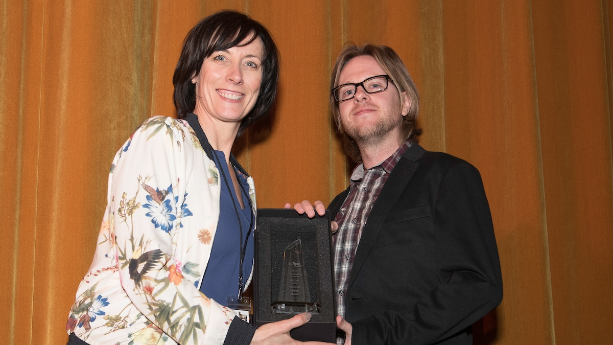 Dawn Morrissey presents award for Most Inspiring Short to Director Paul Horan,  Bless Me Father.