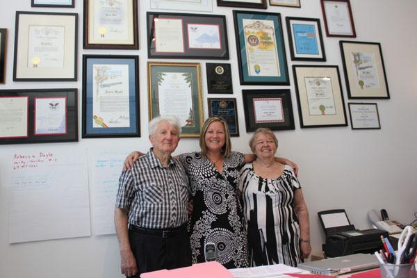 Keren Taylor with her parents in front of WriteGirl Wall of Awards. Photo courtesy Karen Taylor / WriteGirl