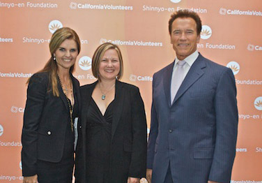 WriteGirl Executive Director accepts the award from the Governor and First Lady of California.