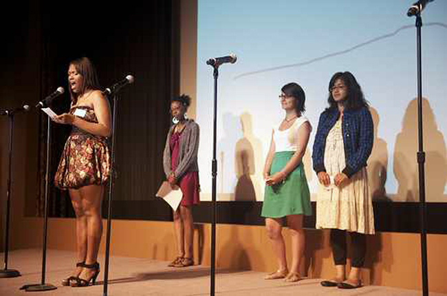 A group of WriteGirl teens perform their work at the Writers Guild of America Theater.