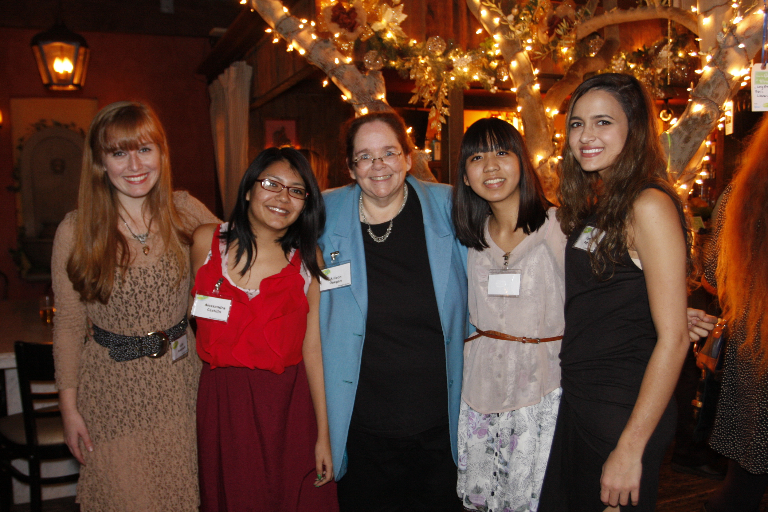 WriteGirl Associate Director Allison Deegan with current mentee Jackie Uy, and alumni mentees Kylie Anderson, Alejandra Castillo, and Camille Patrao.