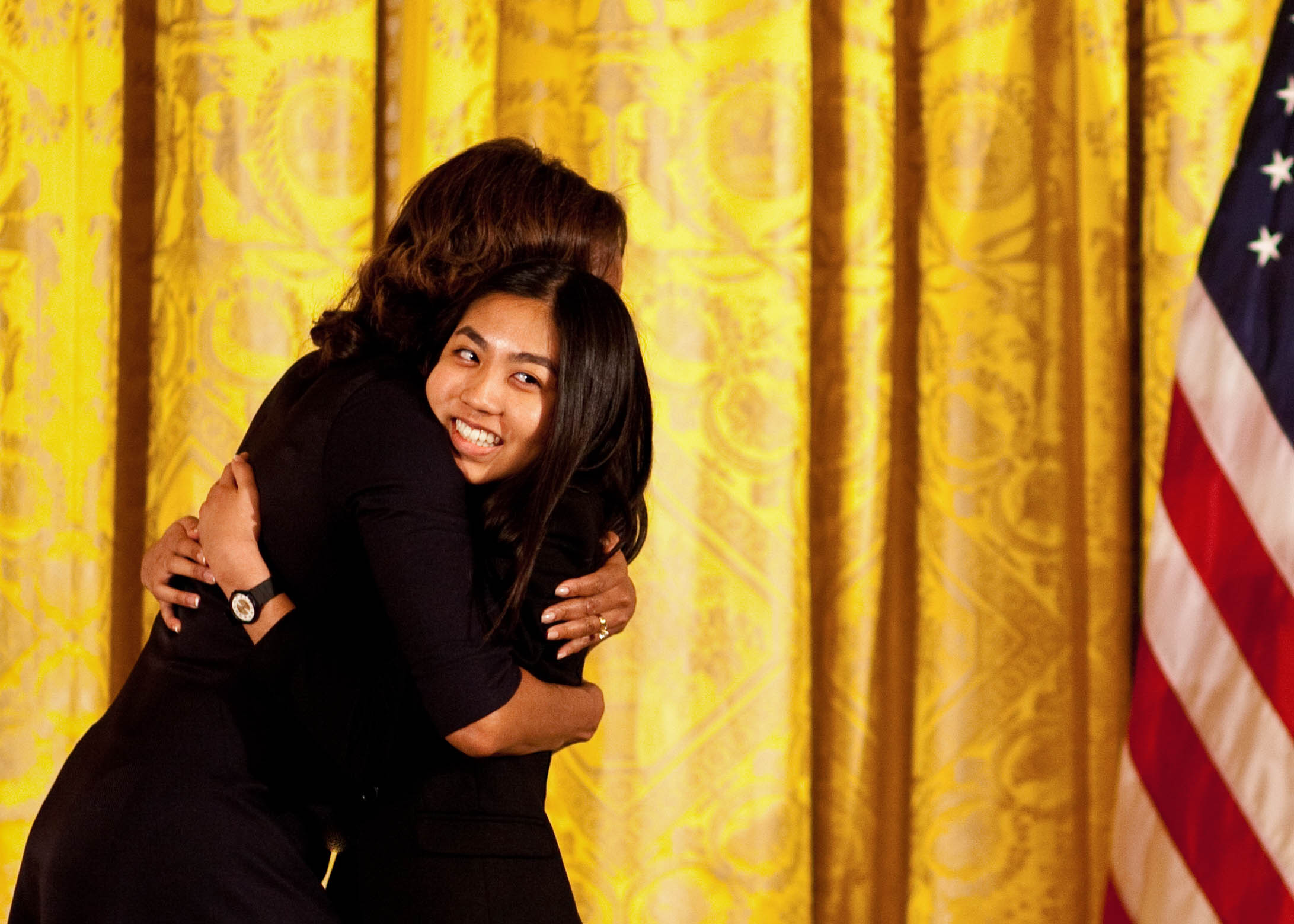 WriteGirl mentee Jackie, 16, sharing a hug with the first lady