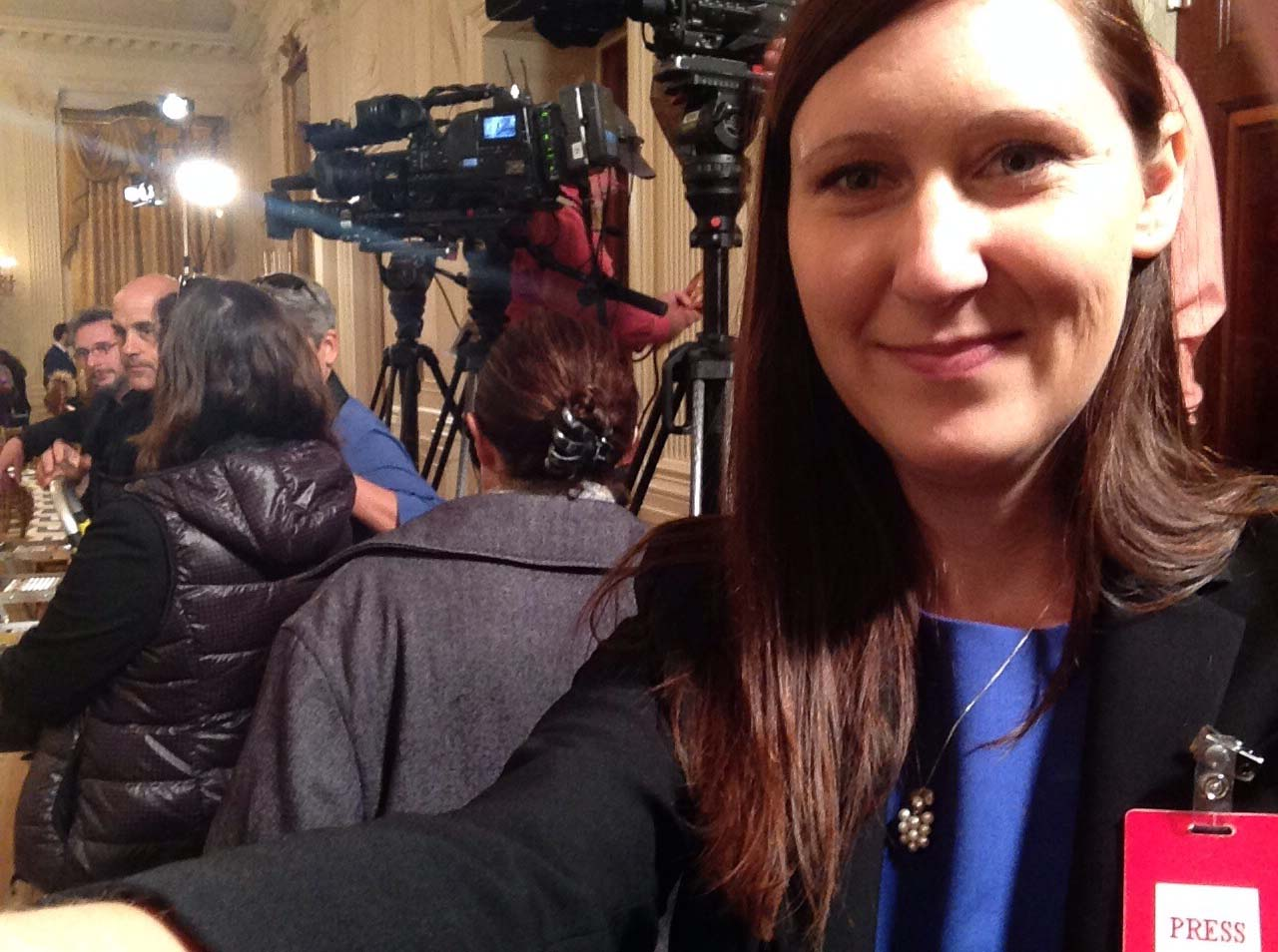 Mentor Katie Geyer taking a selfie with the White House press
