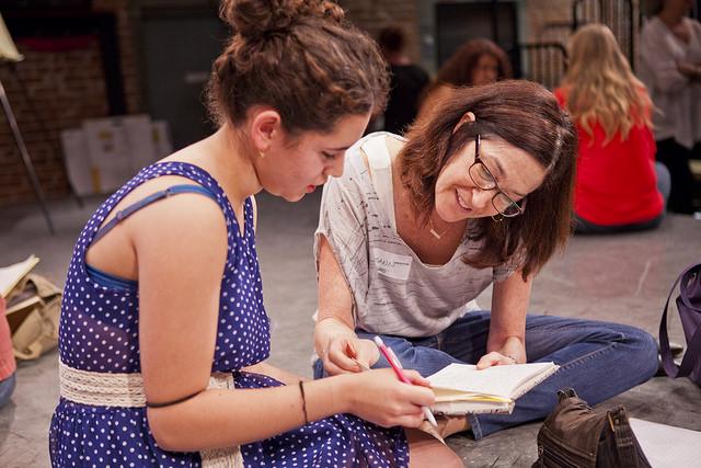 Screenwriter  Josann McGibbon  ( Runaway bride) helps a teen girl write a scene at our screenwriting workshop