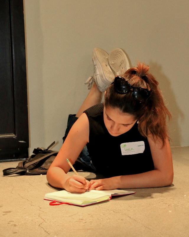 mentee writing in journal.jpg