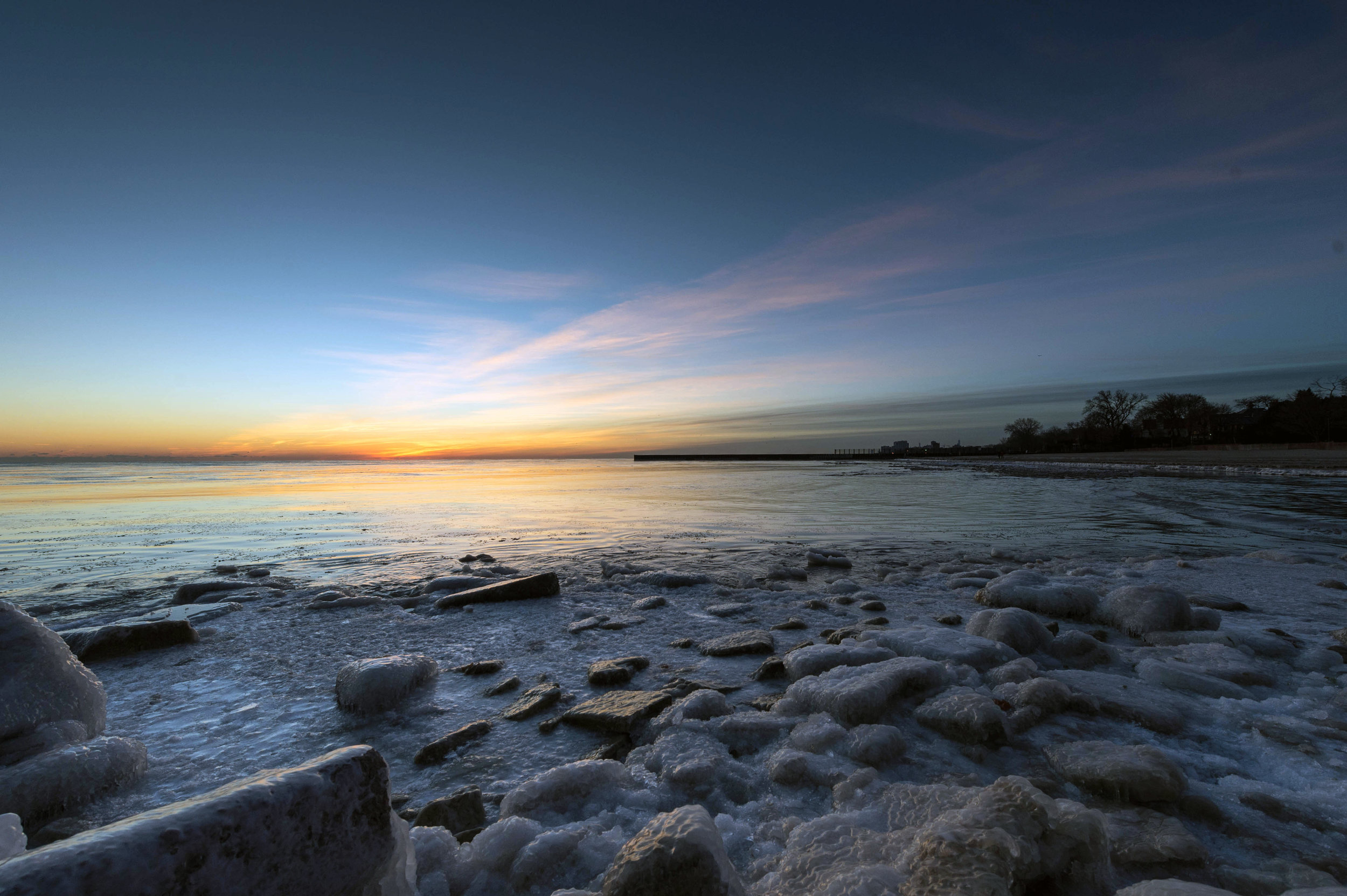 The December calendar image (above), Sunrise and Rocks, was taken on New Year's Day, 2016 at Lee Street Beach in Evanston.