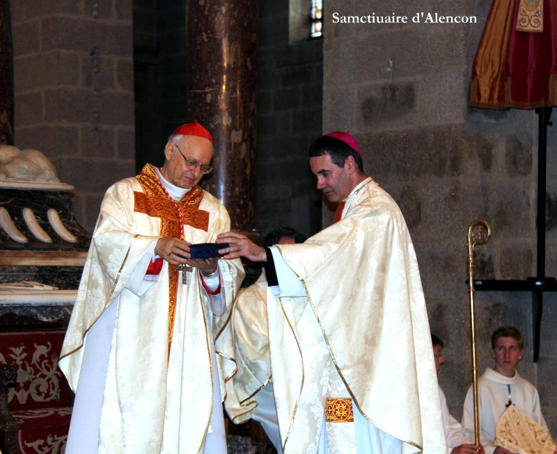 Cardinal Baldisseri, secretary-general of the Synod of Bishops, receives relics of Blessed Louis and Zelie Martin from Mgr Jacques Habert, bishop of Seez.  Basilica of Notre Dame d'Alencon, July 12, 2014