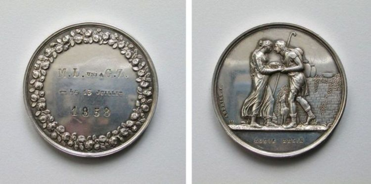 """THE """"marriage medallion"""" designed by st. louis martin and given to st. zelie on their wedding day, reproduced with the permission of fr. antonio sangalli. with thanks to the diocese of sees."""