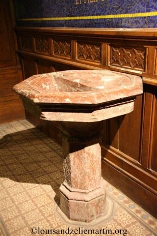 the baptismal font in st. eulalie's church, bordeaux, dating from the time of st. louis martin's baptism.