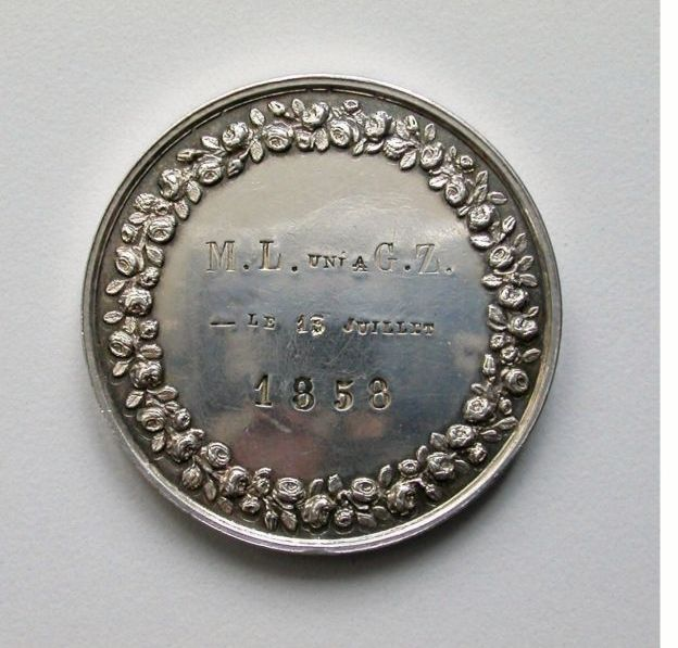 Reverse of the marriage medallion of Louis and Zelie Martin