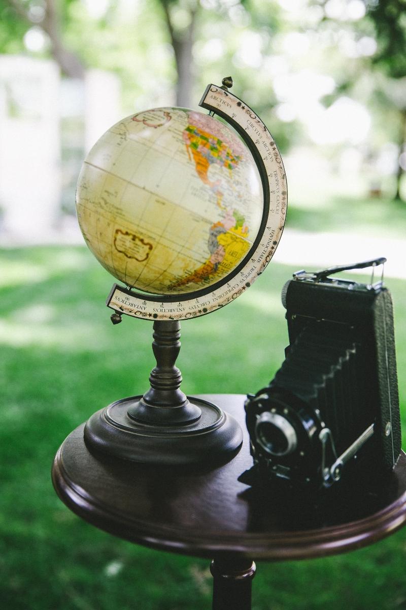 Tabletop Globe and Vintage Camera