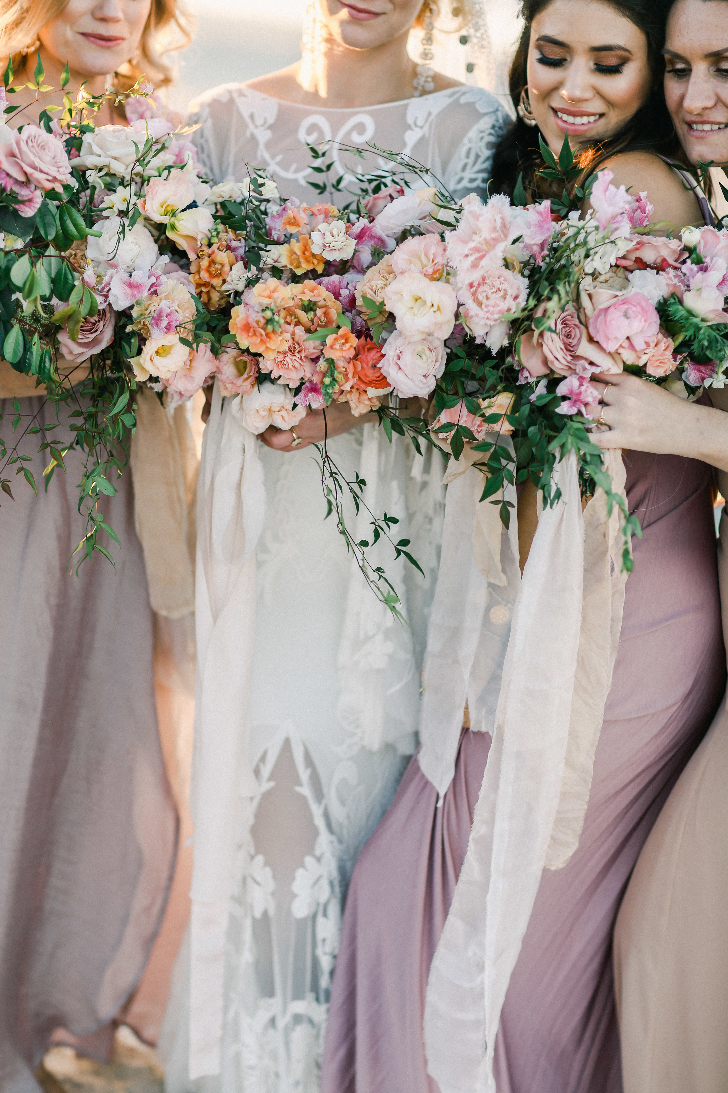 Byron Bay Bride and bridesmaids : pink and taupe dresses : beautiful bouquets .JPG