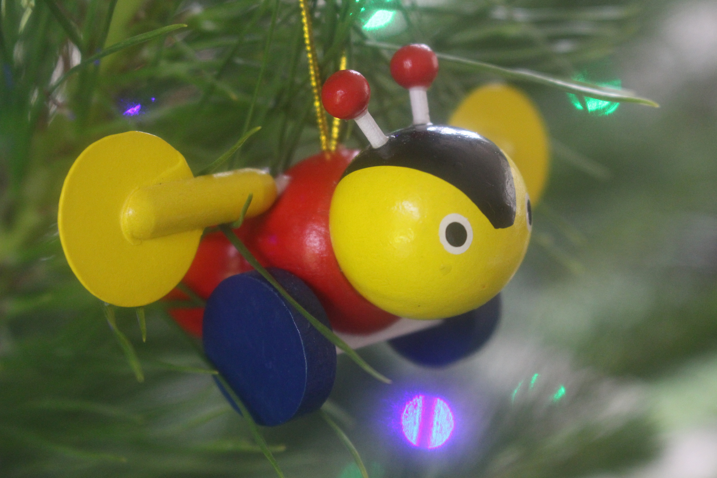 Classic Kiwi Buzzy Bee christmas ornament, photo by Sunstone