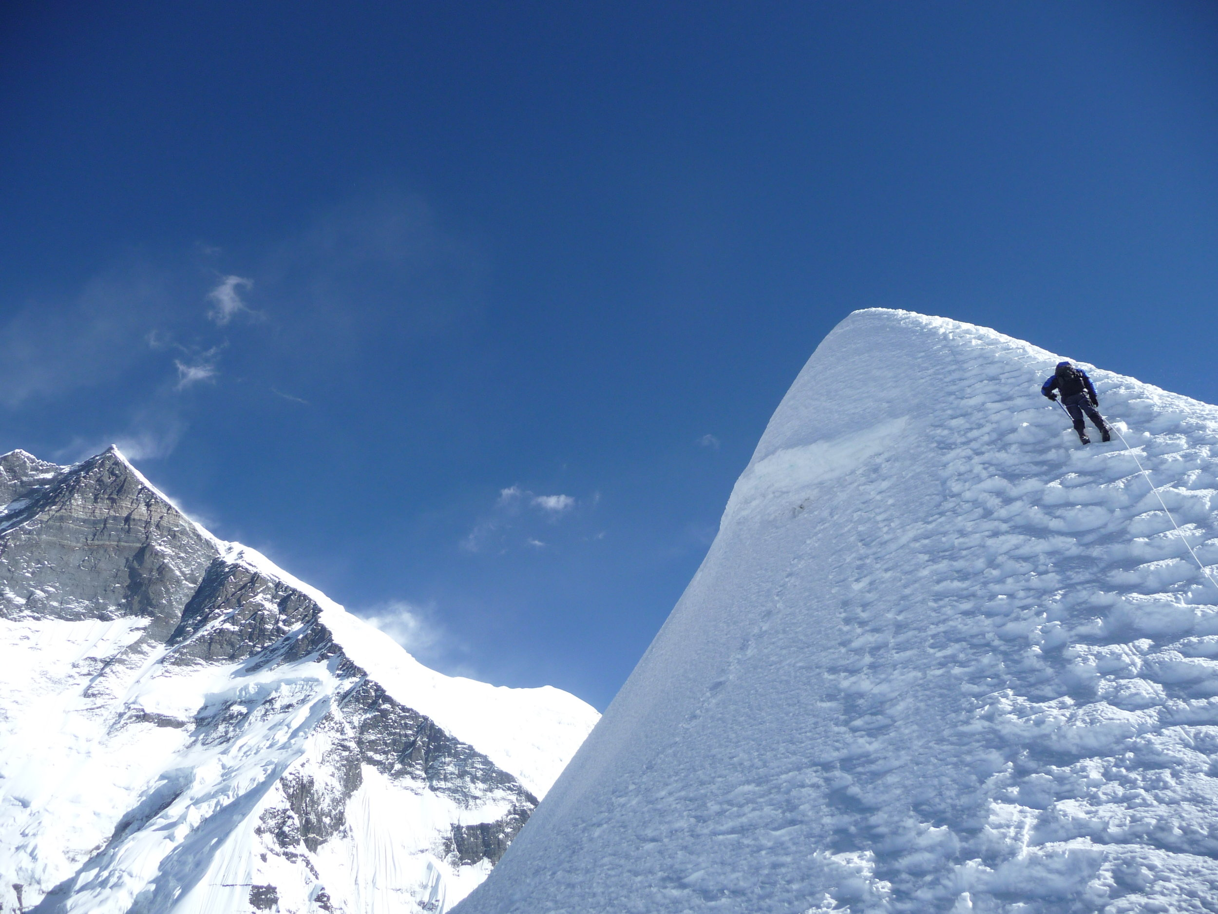 Our lead climber about to Summit Island Peak (6189m), Everest Region, photo by Paul Swettenham