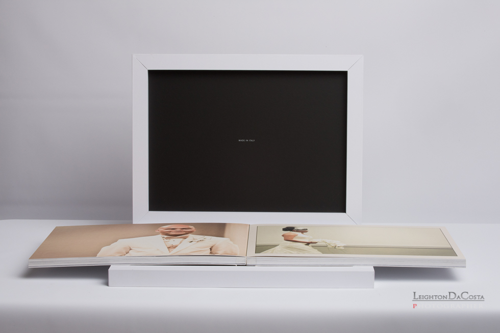 """A Custom made, lay-flat album comes with the Clarendon.  Standard 8x12 album with cover box in """"touch white"""" shown."""