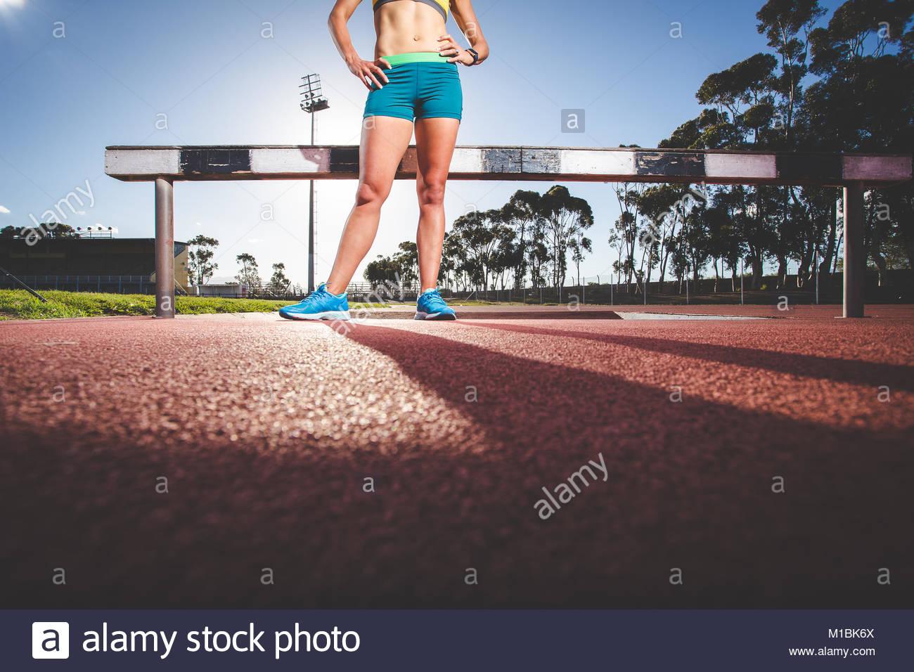 female-fitness-model-and-track-athlete-sprinting-on-an-athletics-track-M1BK6X.jpg